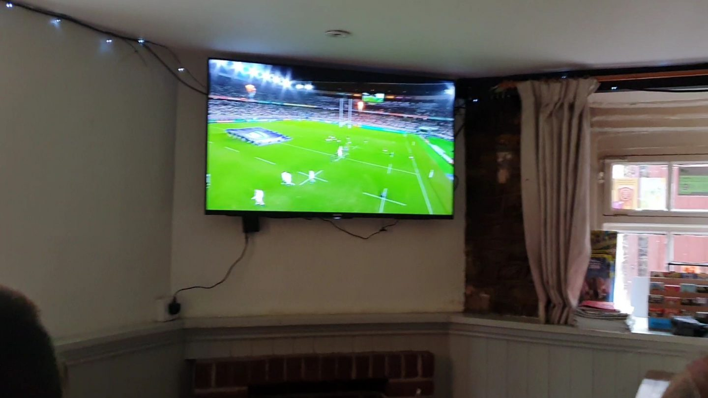 Prime viewing in front of a large wide-screen TV, in a pub and ready to watch the Rugby World Cup Final