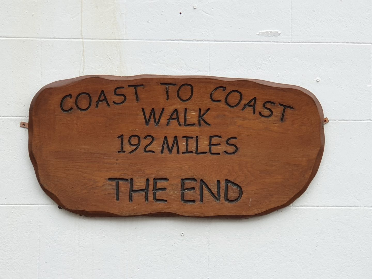 Wooden plaque depicting the end of a 192 miles trail, the Coast to Coast