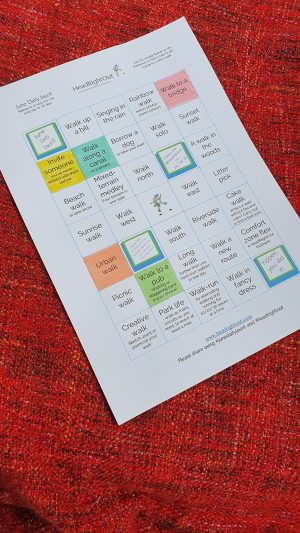 A sheet of white paper with printed text. Some text boxes have been coloured in.